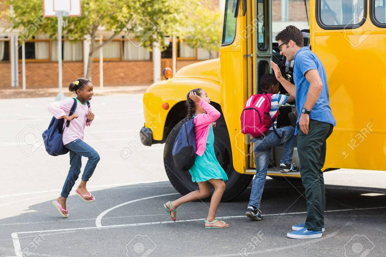 Happy teacher giving high five to kids while entering in bus Standard-Bild - 59228634