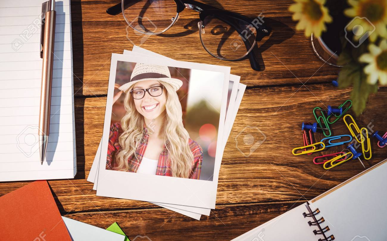 Exceptionnel Gorgeous Smiling Blonde Hipster Posing Against High Angle View Of Office  Supplies On Table Stock Photo
