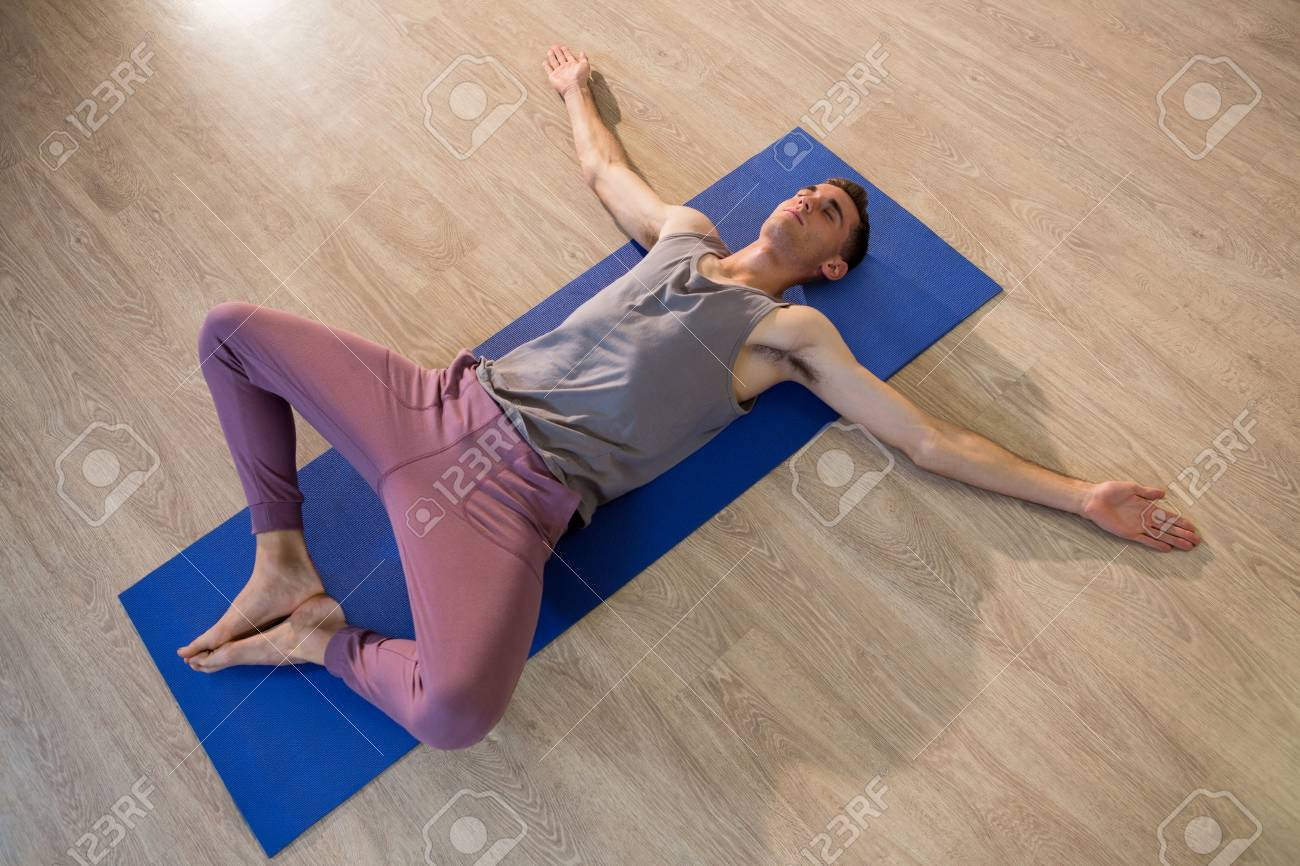 man in yoga corpse pose in gym stock photo picture and royalty free