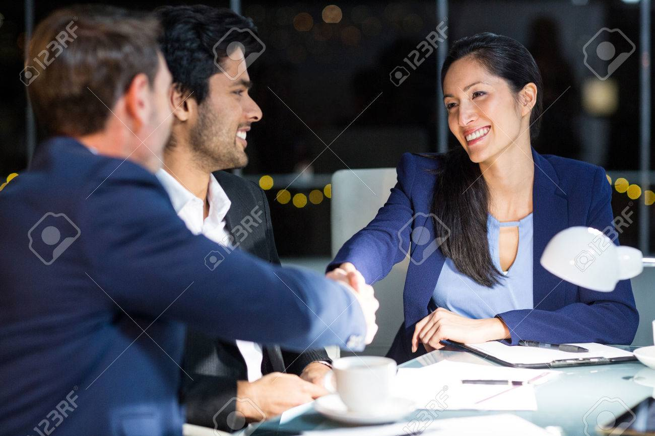 Businessman shaking hands with a colleague in the office Standard-Bild - 64379122