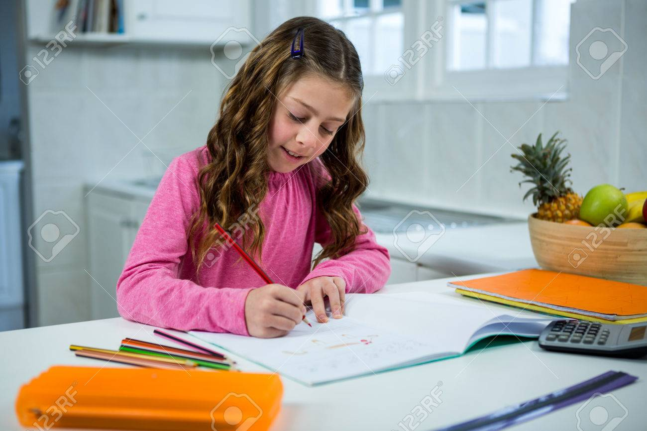 Girl Doing Her Homework At Home In The Kitchen Stock Photo, Picture ...