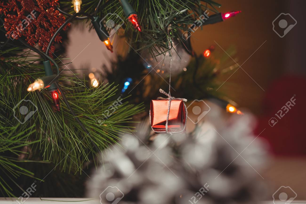 Close Up Of Fairy Light And Small Gift Box Hanging On Christmas Tree Stock  Photo