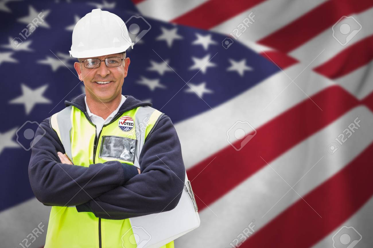 Stock Photo - Worker wearing hard hat in warehouse against close up of the us  flag 5083bfc618c