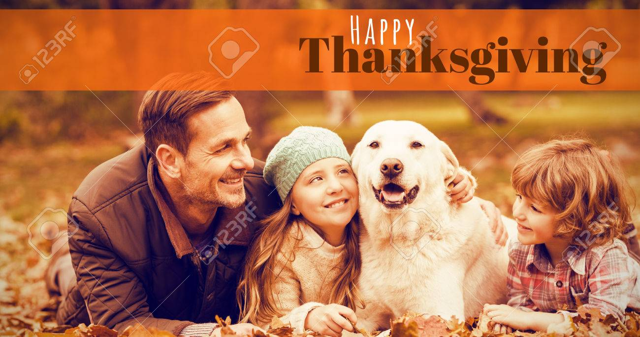 Digitally generated image of happy thanksgiving text against smiling young family with dog - 65351551