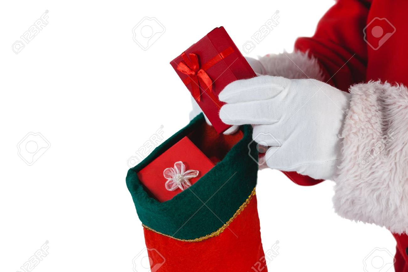 Close-up Of Santa Claus Putting Presents In Christmas Stockings ...