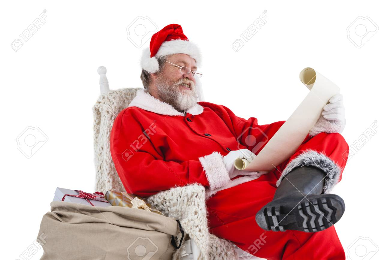 A Christmas Wish.Santa Claus Reading A Christmas Wish List On Scroll Against White