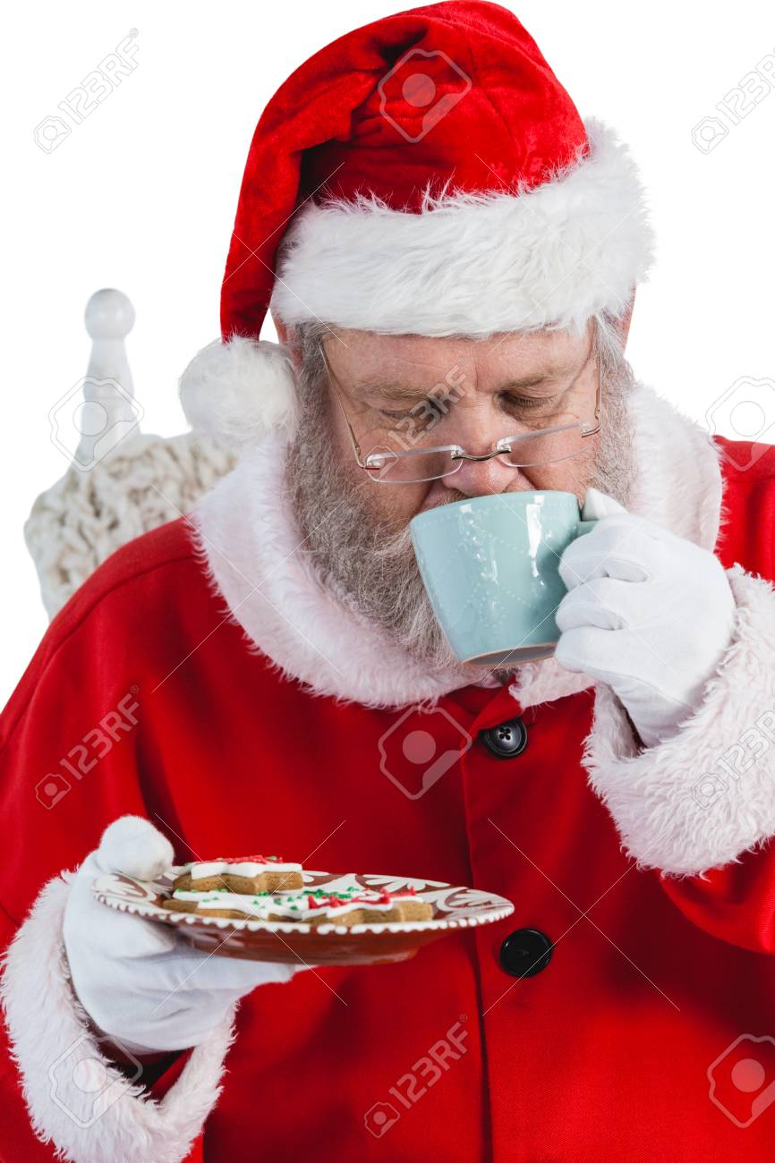 Santa Claus Having A Cup Of Coffee With Cookies On Plate