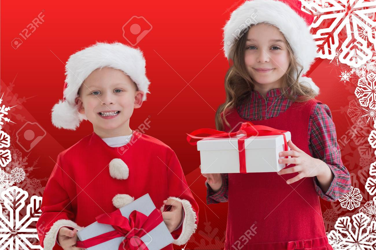 Portrait Of Two Happy Kids In Santa Costume Holding A Christmas ...