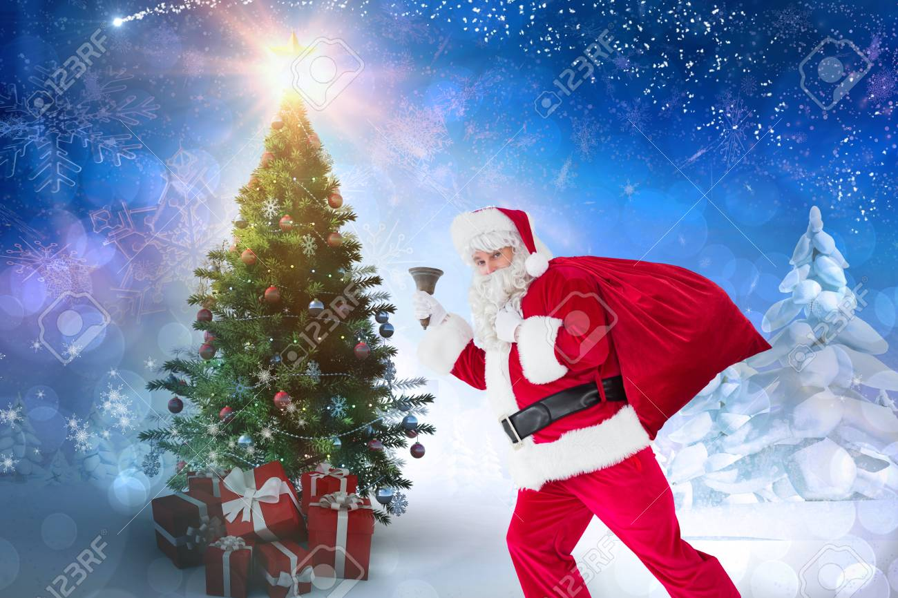 Christmas Background Portrait.Portrait Of Woman In Santa Costume Holding Gifts Against Christmas