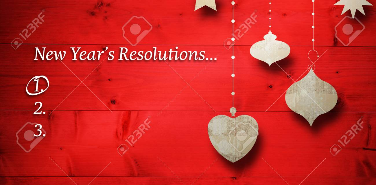 new years resolution list against christmas decorations over wood stock photo 66282756