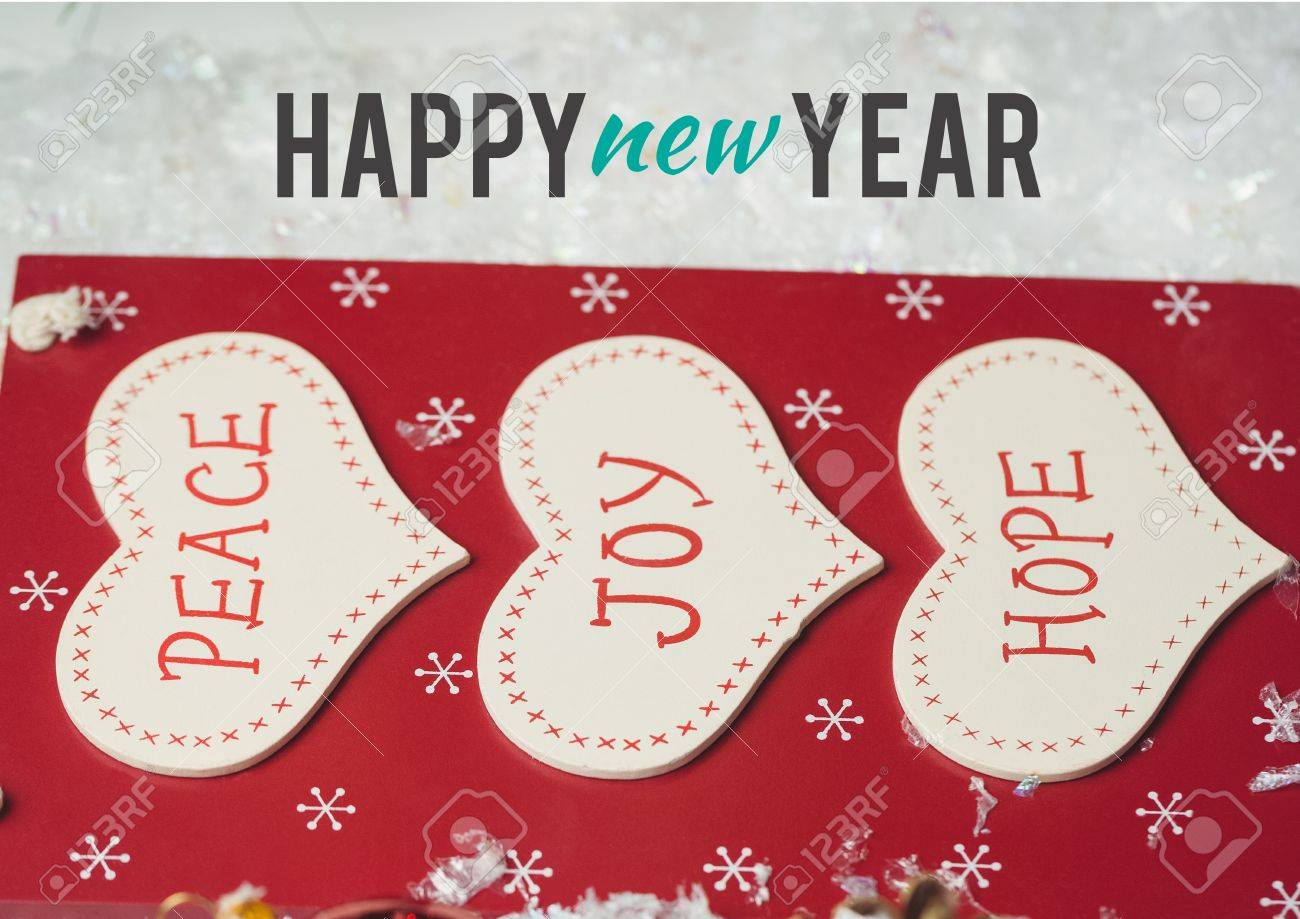 happy new year wishes with message of peace joy and hope on heart stock photo