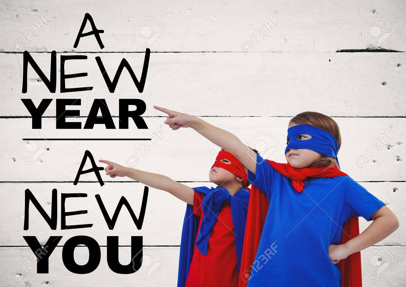Children In Super Hero Costumes Pointing At New Year Greeting ...
