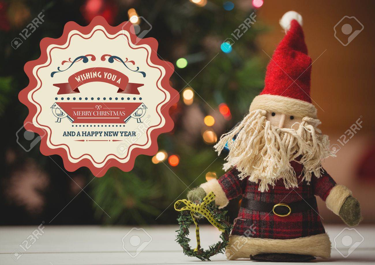 New Year Greeting Quotes With Santa Doll Against Christmas Tree