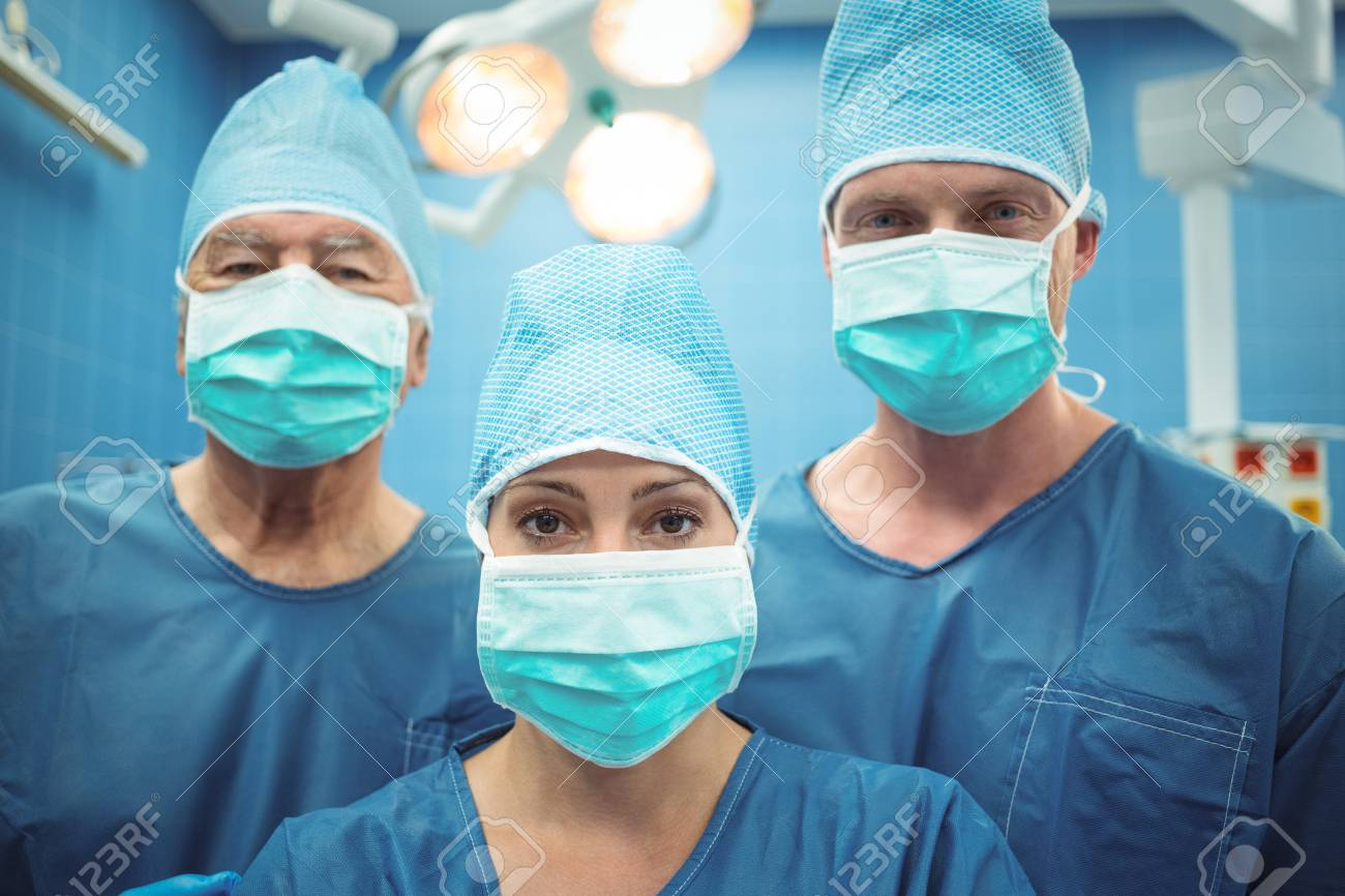 Operation Mask Theater At In Wearing Surgical Team Of Surgeons