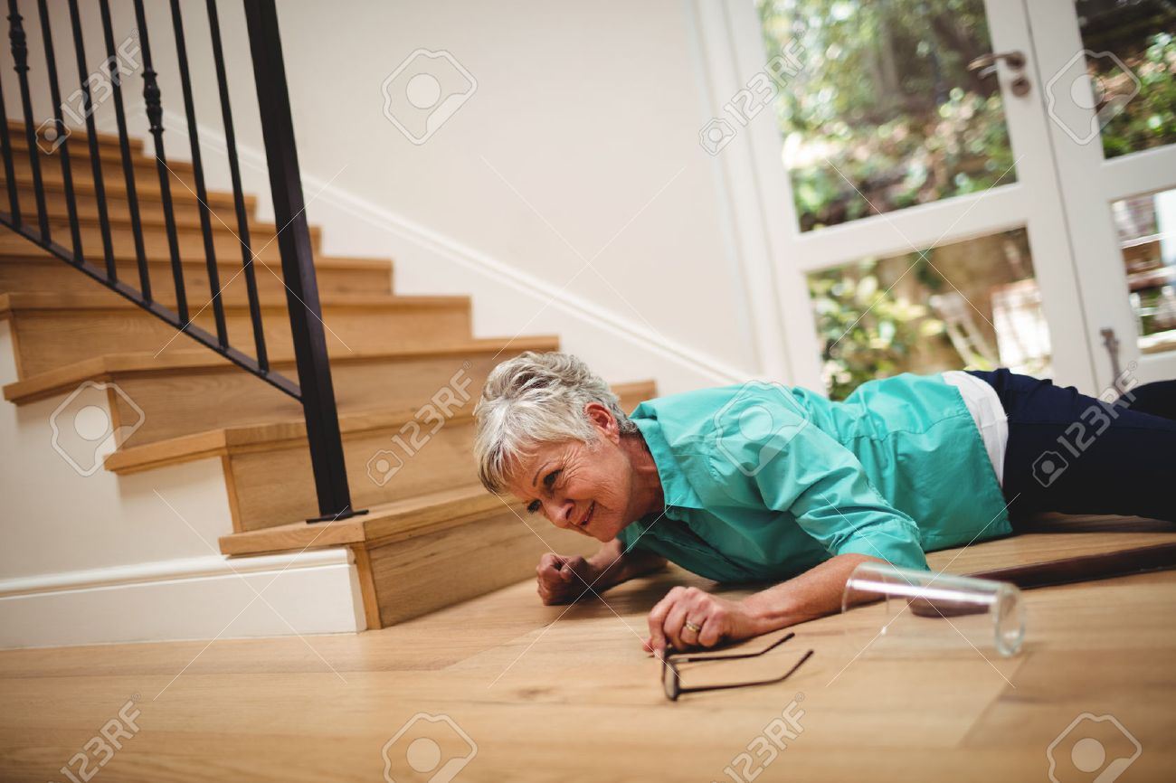 Senior woman fallen down from stairs at home Banque d'images - 69603925