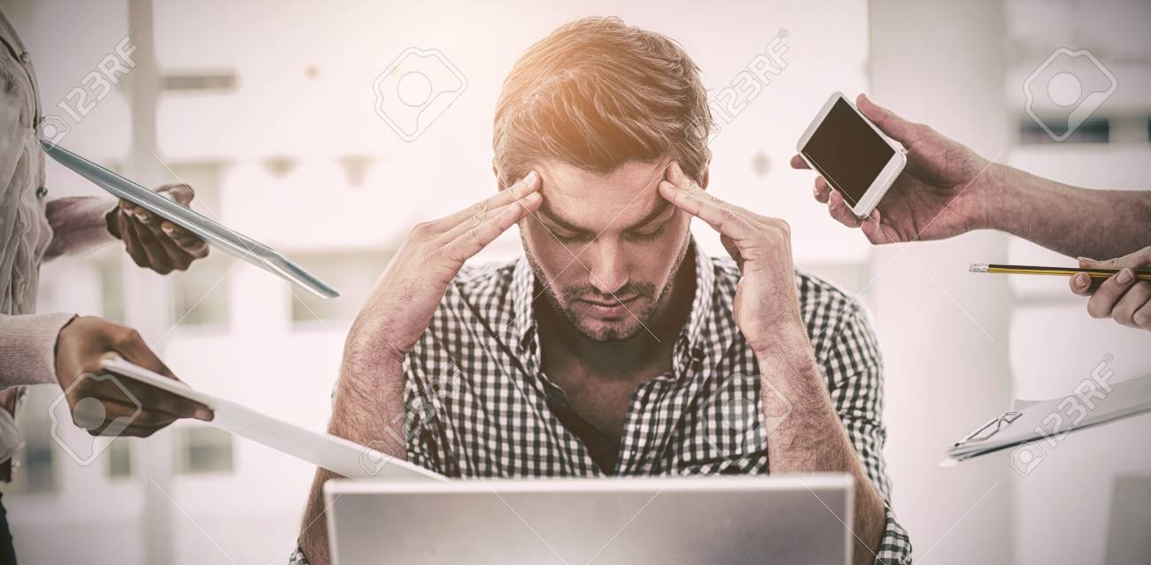 Businessman stressed out at work in casual office - 69609449