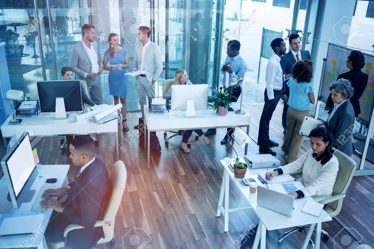 Business people interacting while working in office - 70129279