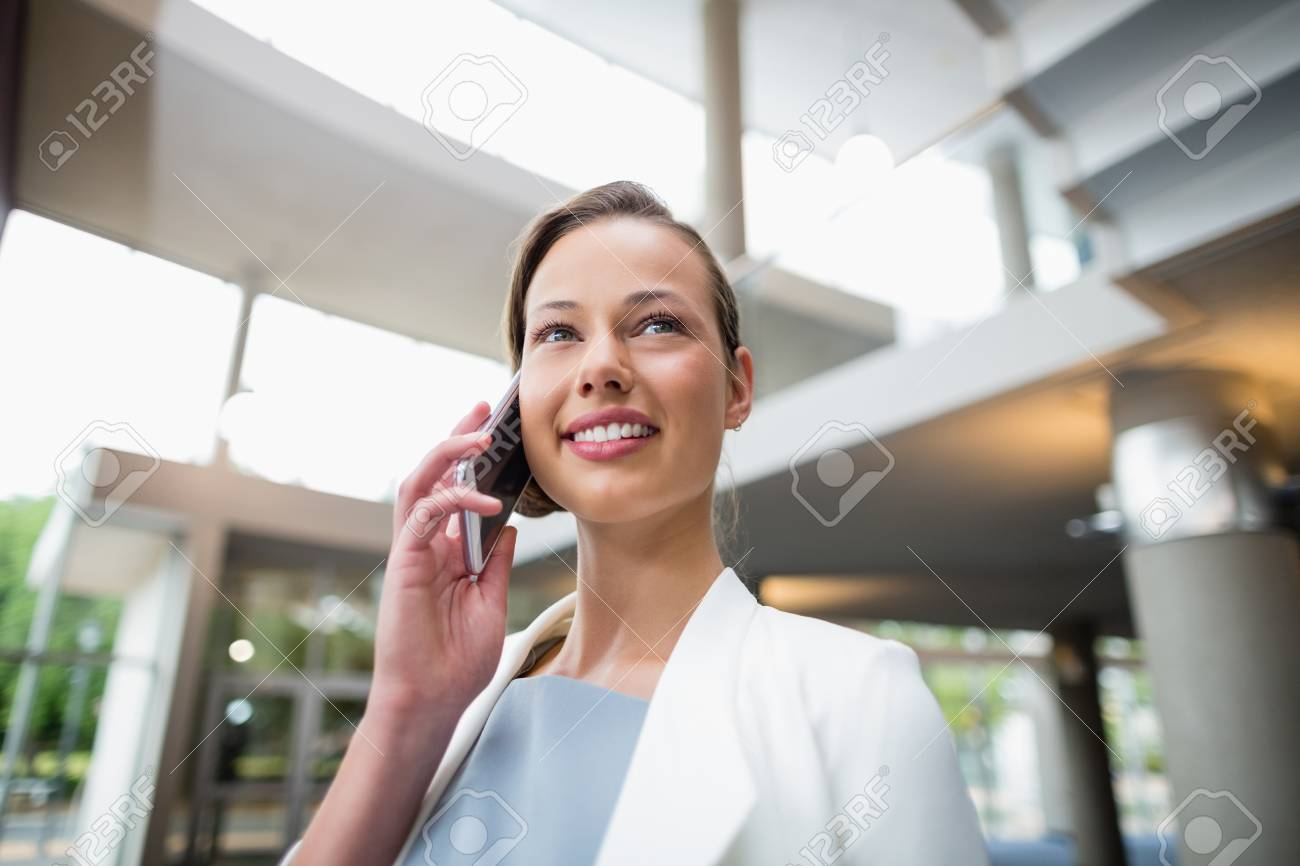 Happy Businesswoman Talking On Mobile Phone At Conference Centre