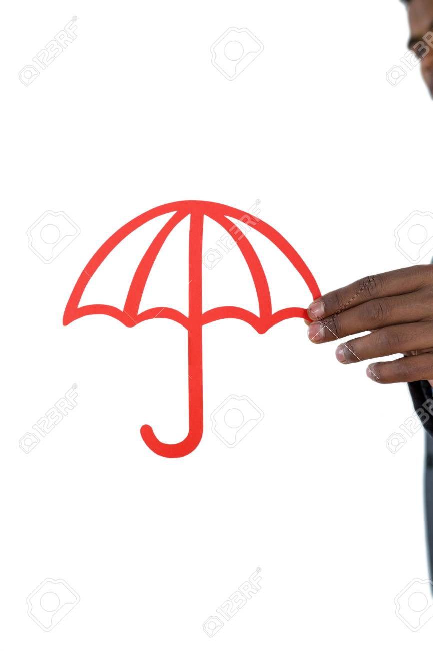 Close Up Of Businessman Holding Cut Out Umbrella Against White Background Stock Photo