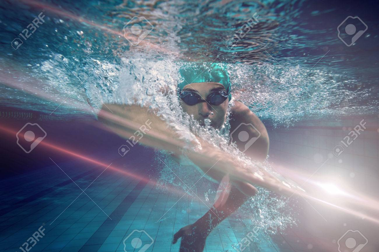 Fit swimmer training by himself against graphic image of flare - 72224424