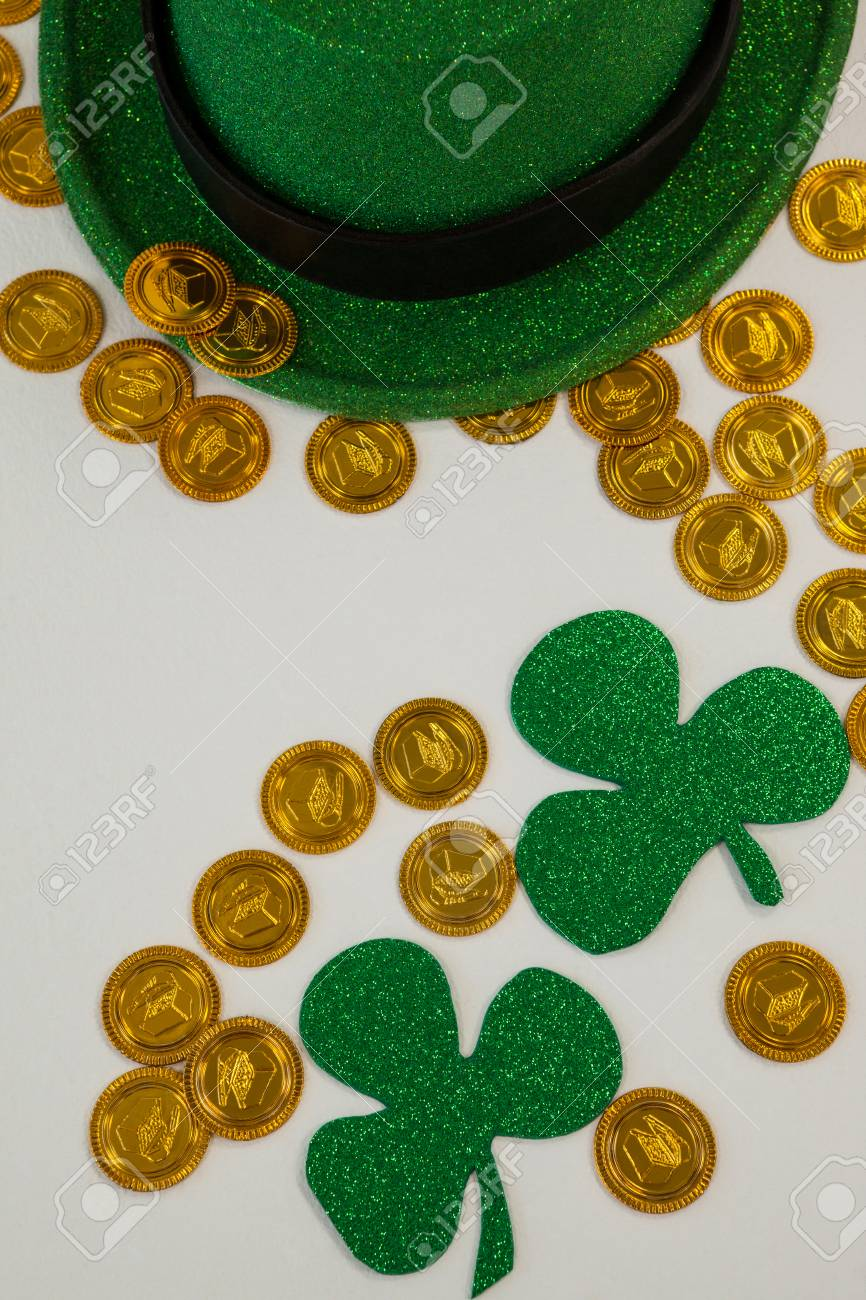 St Patricks Day Leprechaun Hat Shamrocks And Chocolate Gold Coins On White Background Stock