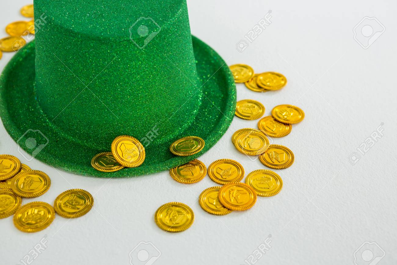 St Patricks Day Leprechaun Hat And Chocolate Gold Coins On White Background Stock Photo