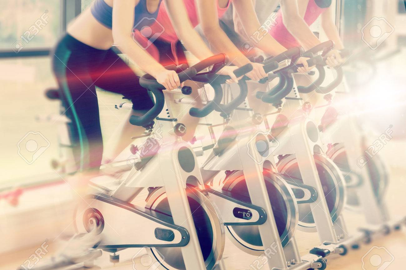 Abstract background against low section of people working out at spinning class - 72703128