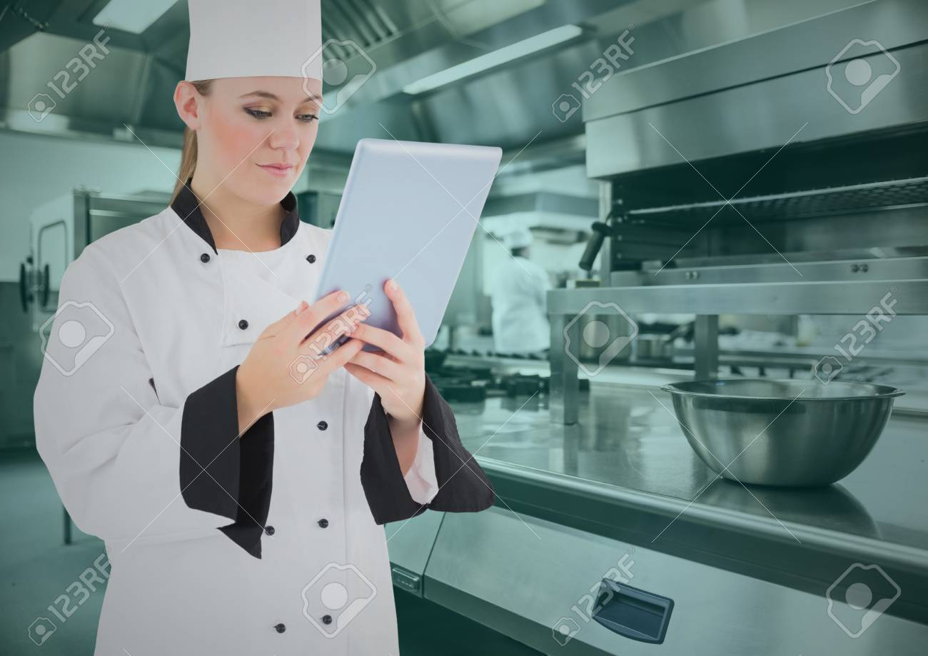 Composite Image Of Chef Using Digital Tablet In Commercial Kitchen ...