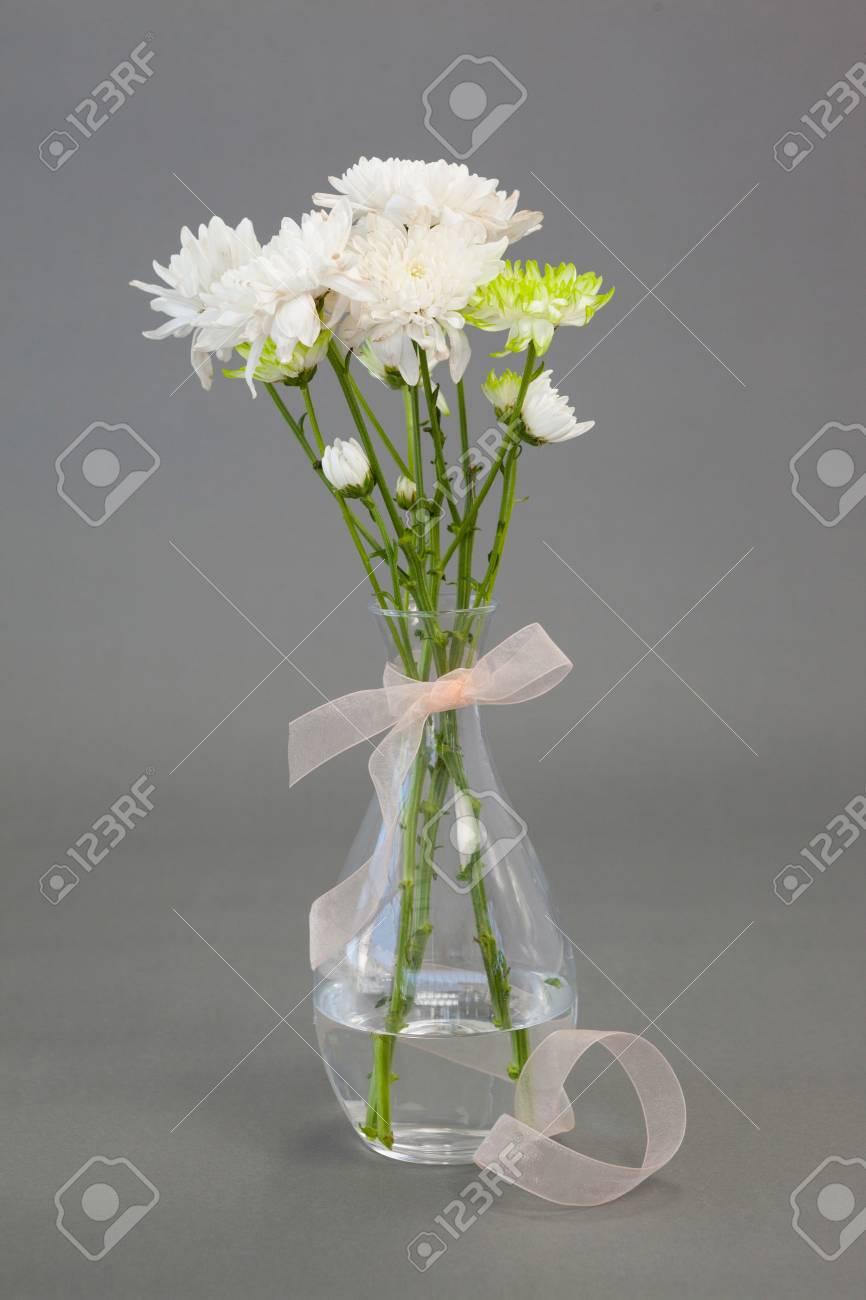 Flower Vase Tied With Ribbon On Grey Background Stock Photo, Picture on ribbon table, ribbon wedding, ribbon mirror, ribbon cutting board, ribbon letter k, ribbon white, ribbon orange, ribbon figure, ribbon window, ribbon gift, ribbon plate, ribbon painting, ribbon boxes, ribbon display case, ribbon light, ribbon decorating, ribbon shadow box, ribbon art, ribbon glass, ribbon cupboard,