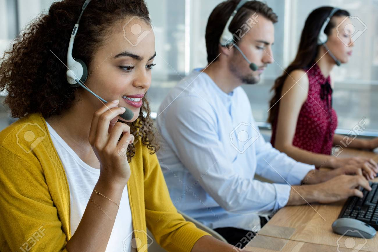 Customer service executives working at office - 74652276