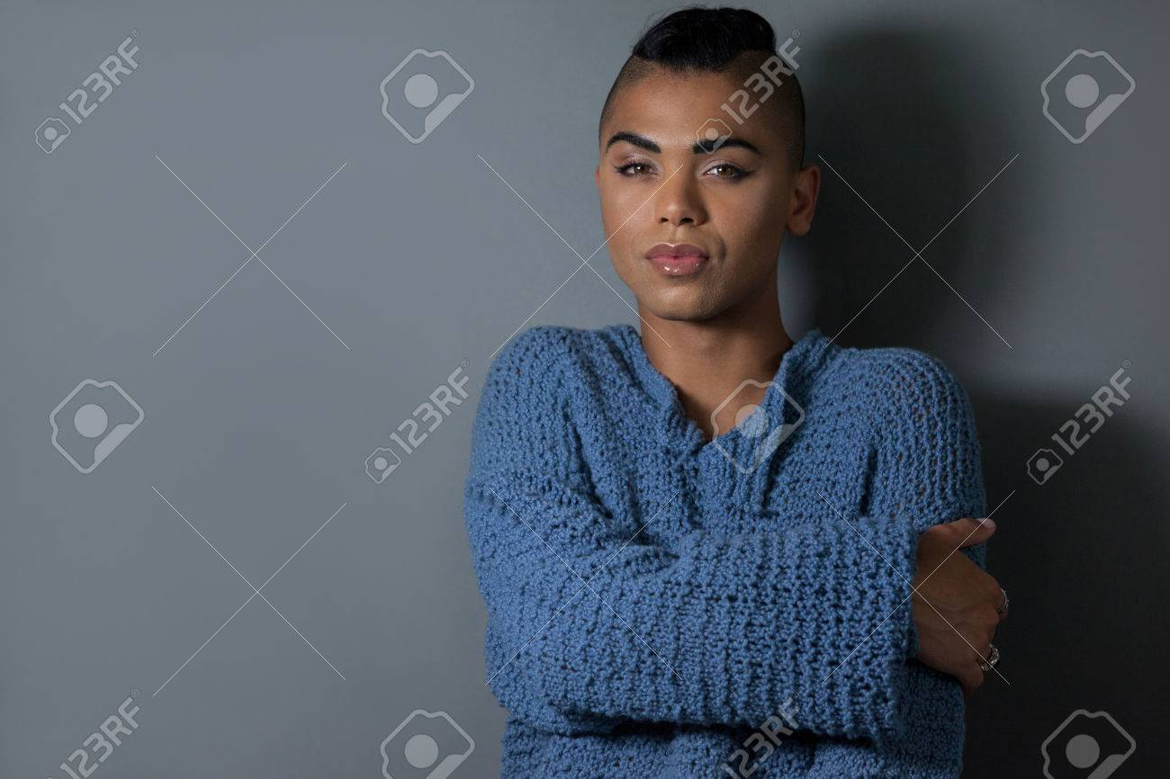 Portrait of confident embracing against gray background - 76068827