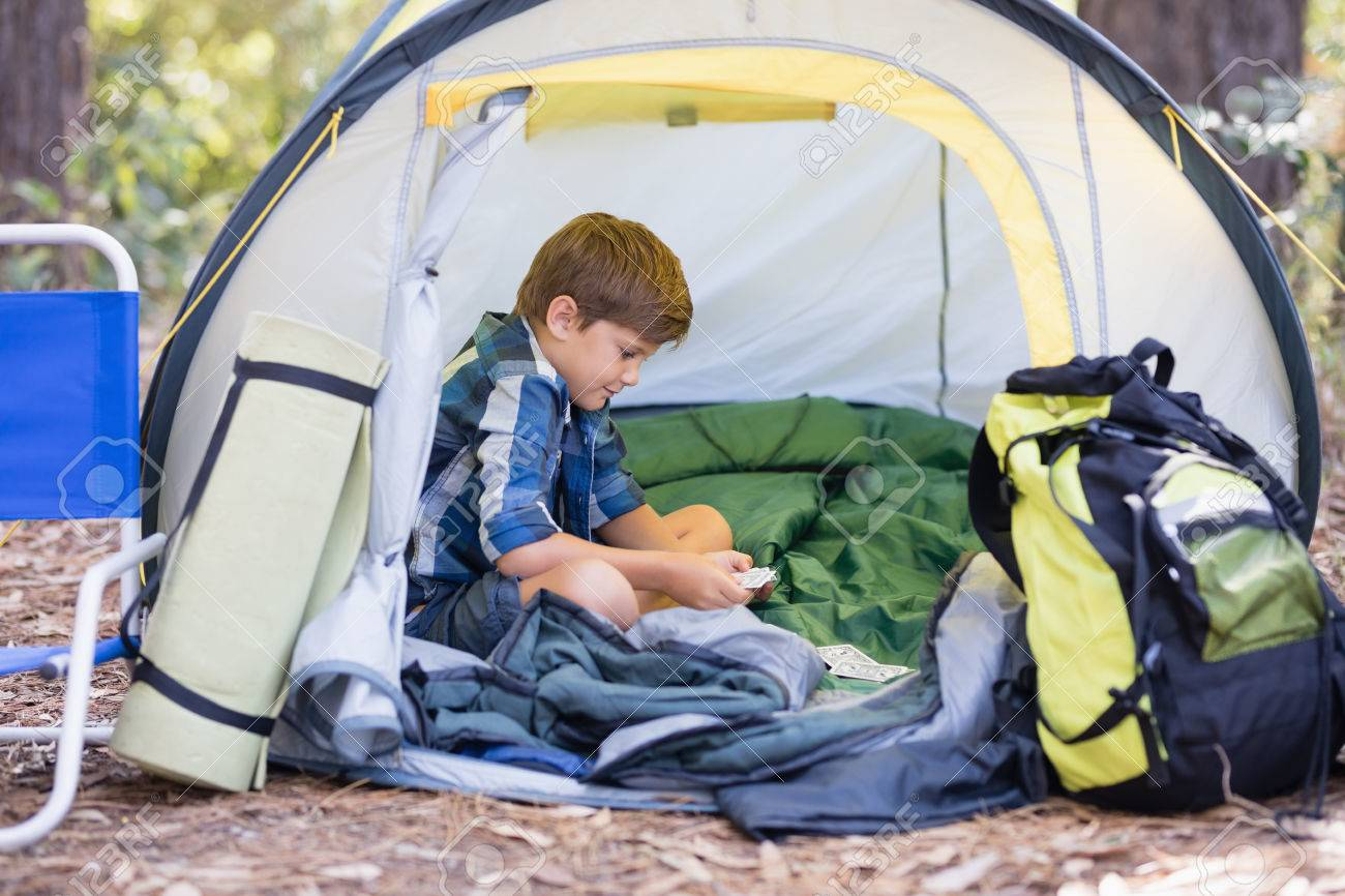 Little boy sitting inside tent while hiking in forest Stock Photo - 77599052  sc 1 st  123RF Stock Photos & Little Boy Sitting Inside Tent While Hiking In Forest Stock Photo ...