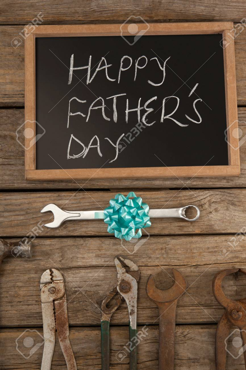 happy fathers day message with old and new worktools on wooden plank stock photo 79276100