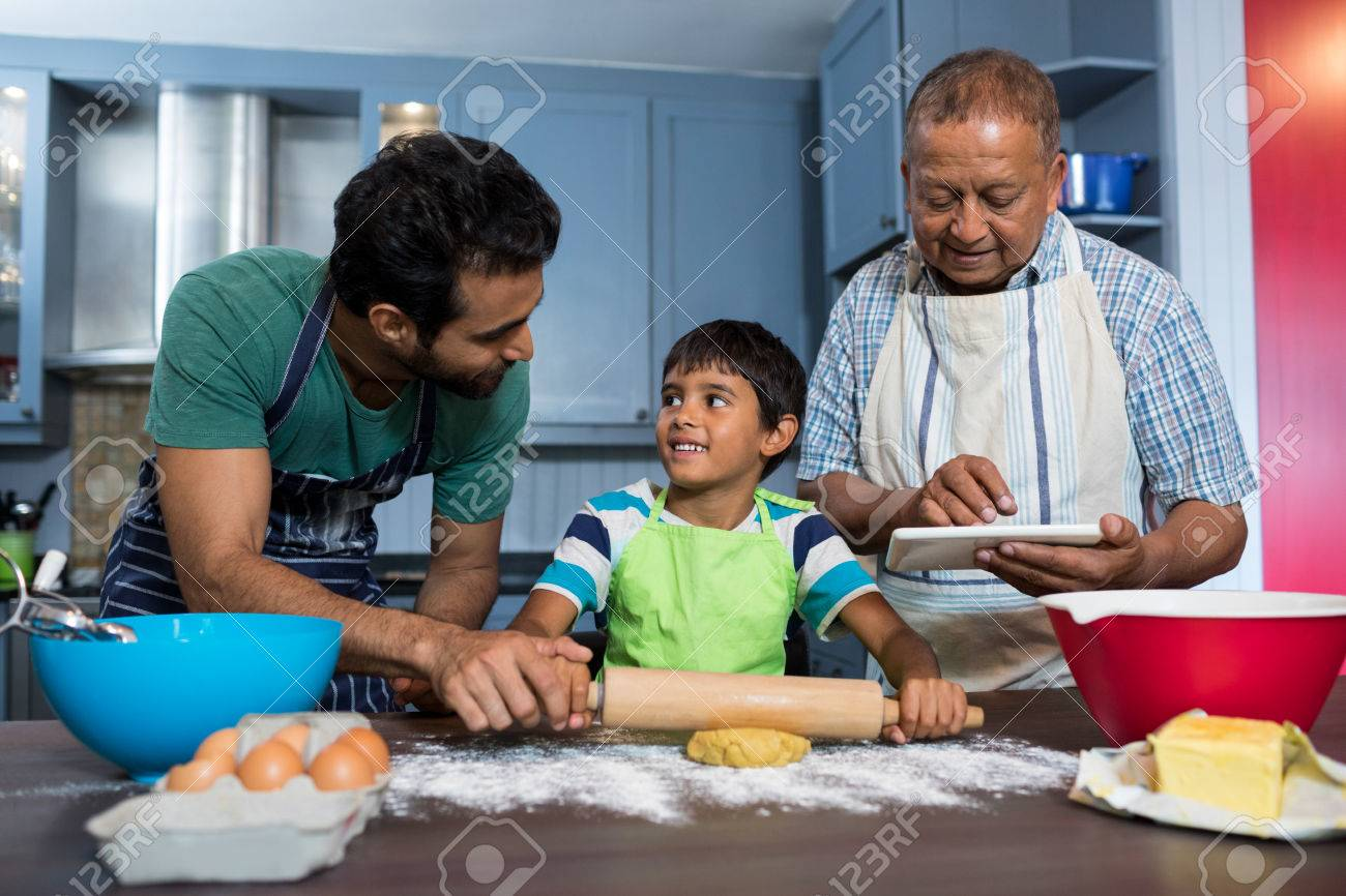 Man Using Table While Standing By Father And Son Preparing Food ...