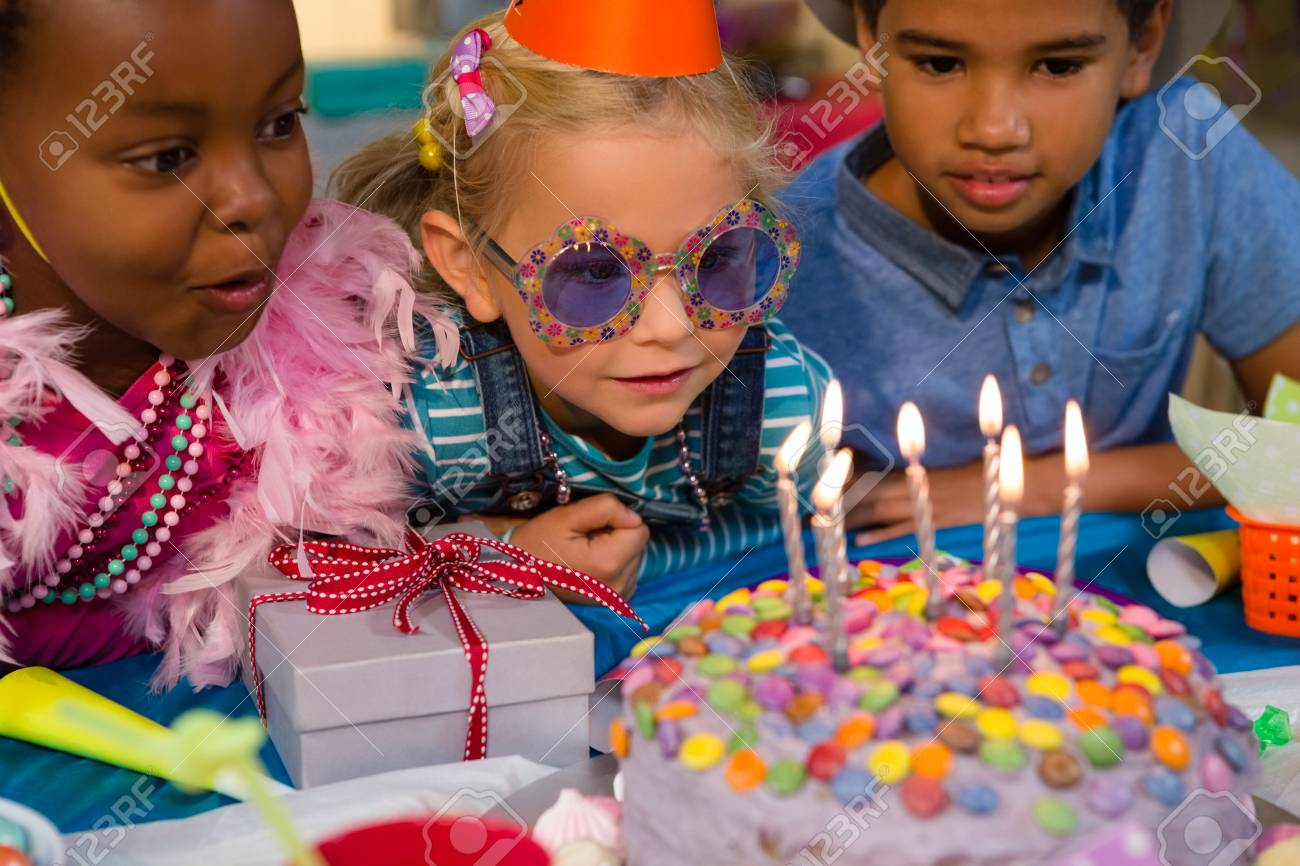 Strange Close Up Of Children Looking At Birthday Cake During Party Stock Birthday Cards Printable Benkemecafe Filternl