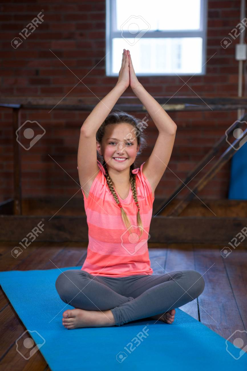 Portrait Of Happy Teenage Girl Practicing Yoga In Fitness Studio Stock Photo Picture And Royalty Free Image Image 83561341