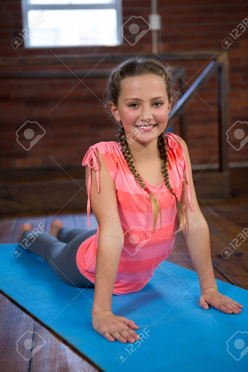 Portrait Of Happy Teenage Girl Practicing Yoga In Fitness Studio Stock Photo Picture And Royalty Free Image Image 83561947