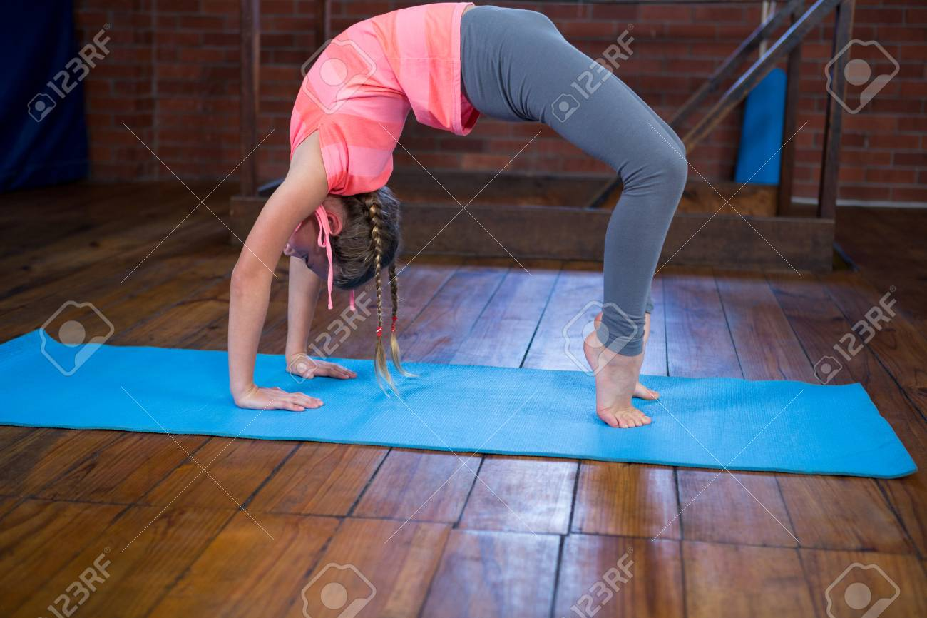 Teenage Girl Practicing Yoga In Fitness Studio Stock Photo Picture And Royalty Free Image Image 83562094