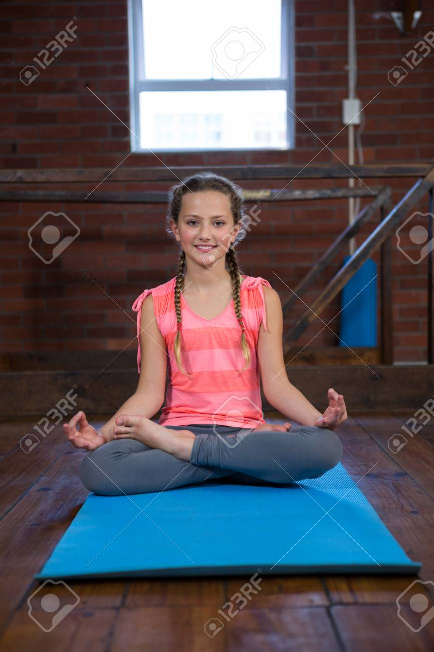 Portrait Of Teenage Girl Practicing Yoga In Fitness Studio Stock Photo Picture And Royalty Free Image Image 83562120