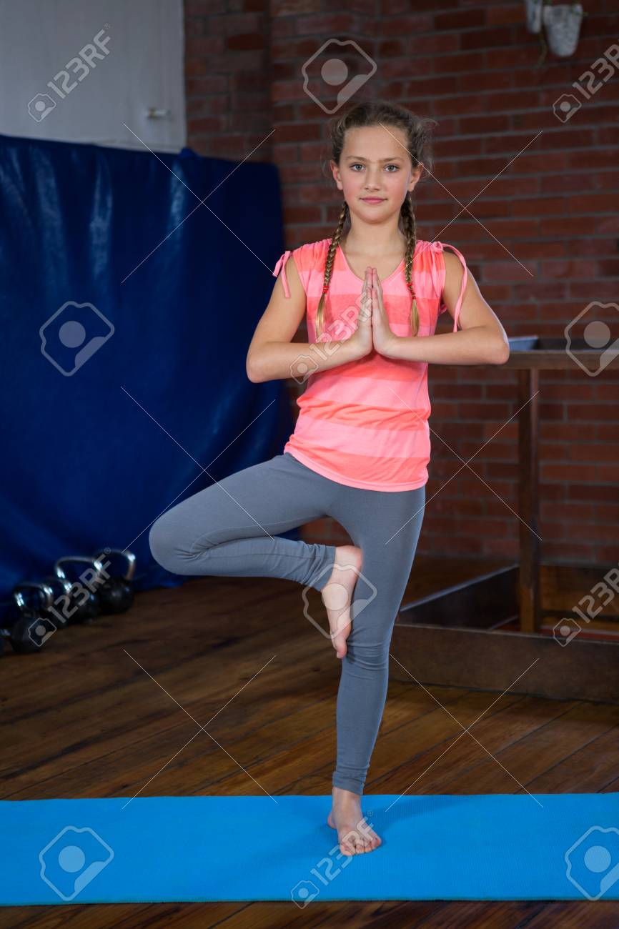 Portrait Of Teenage Girl Practicing Yoga In Fitness Studio Stock Photo Picture And Royalty Free Image Image 83562121