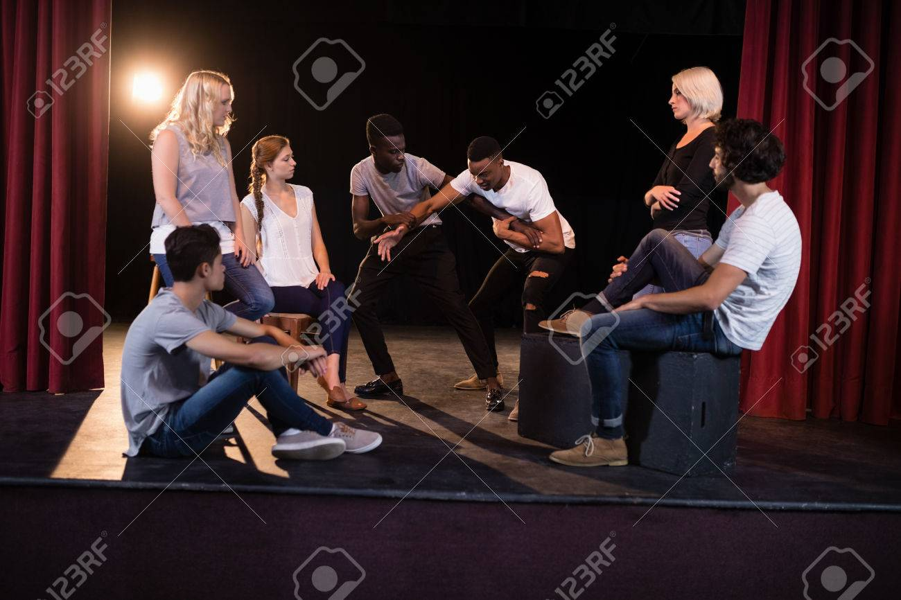 Actors practicing play on stage in theatre - 84503007
