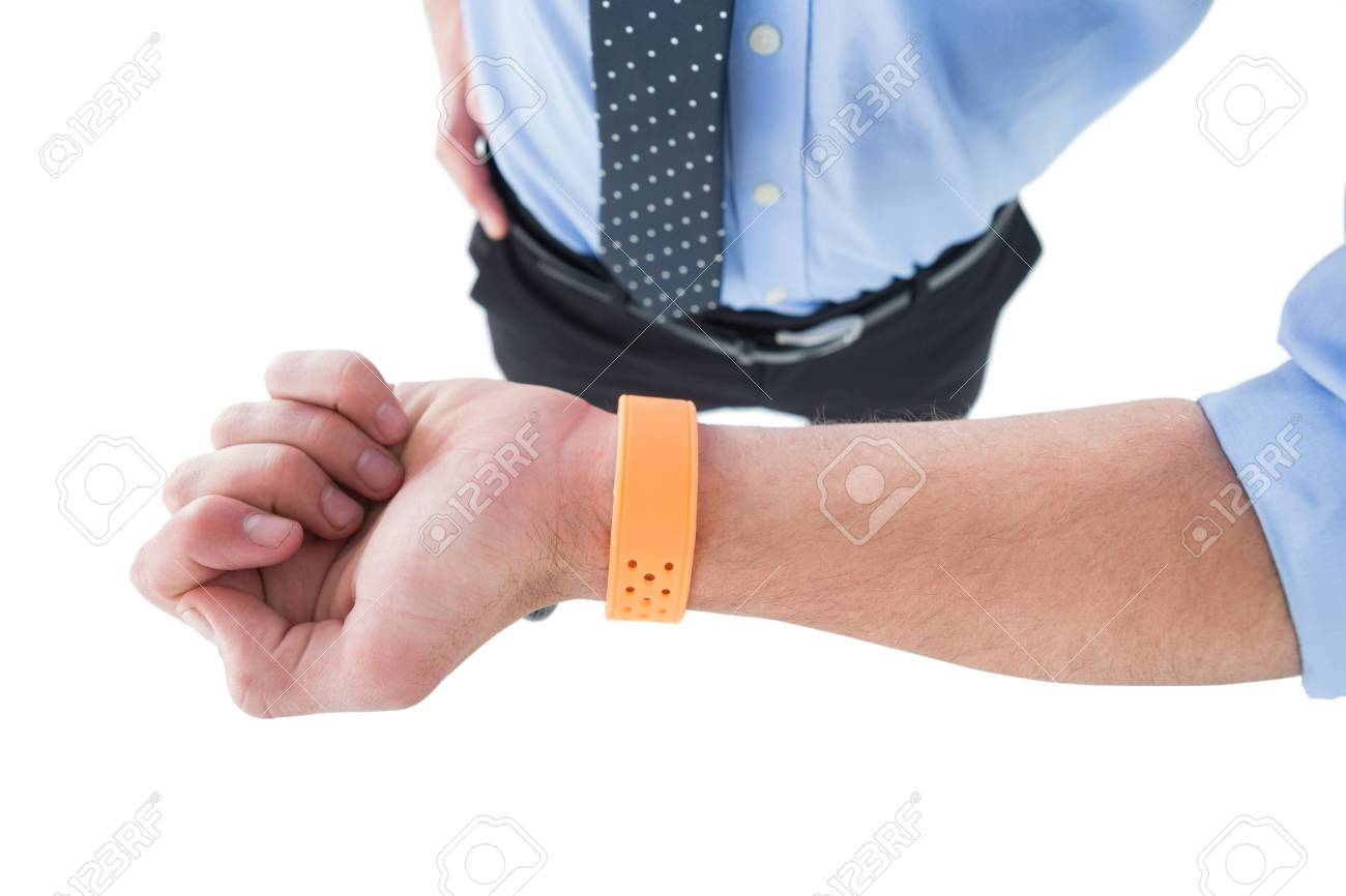 High angle view of businessman wearing smart watch while standing