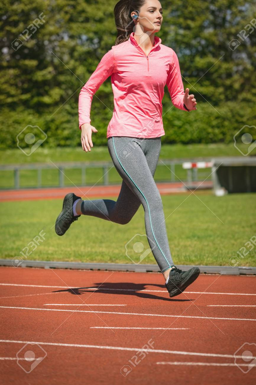 young woman jogging on a race track stock photo picture and royalty