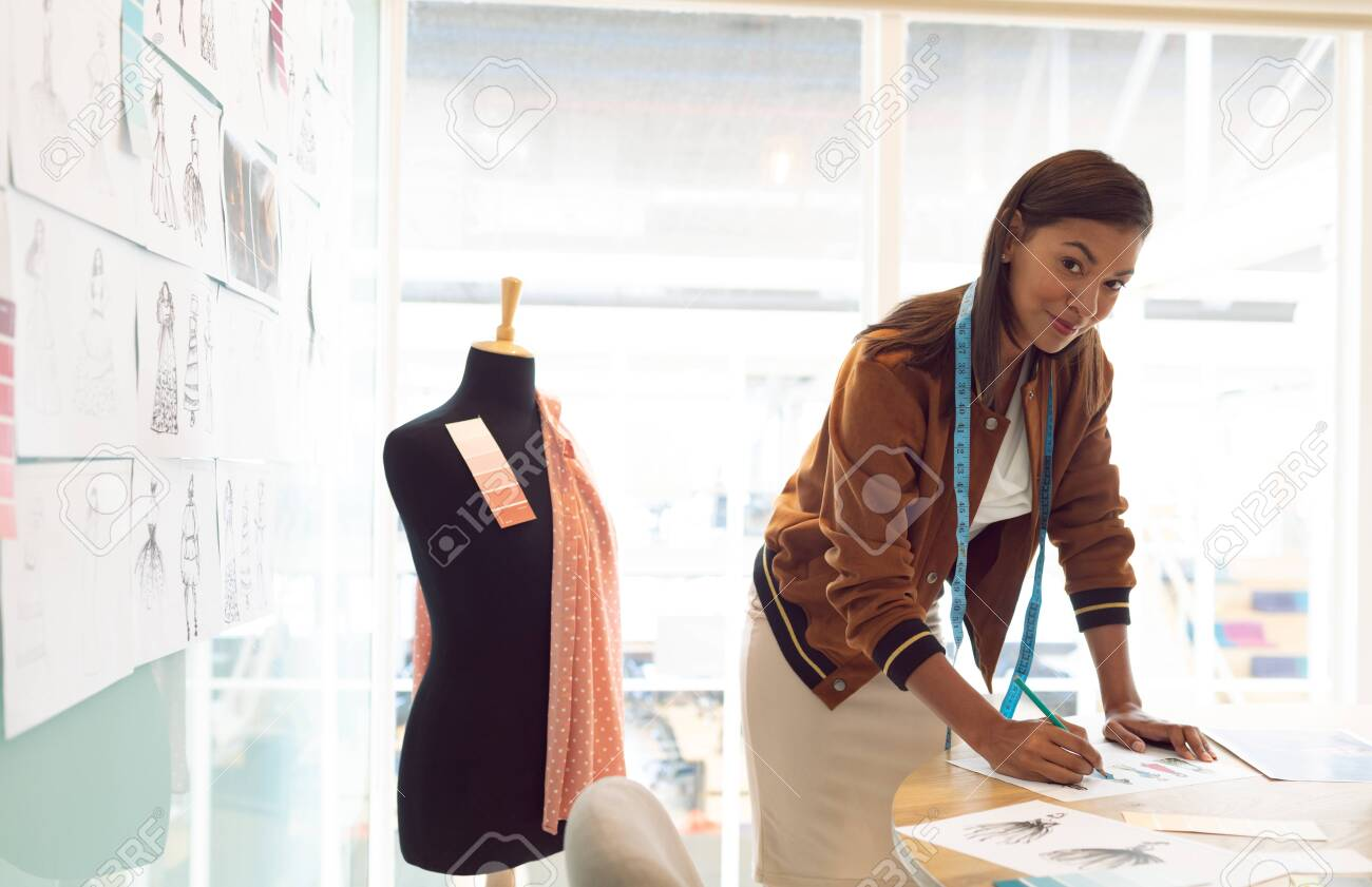 Side View Of Mixed Race Female Fashion Designer Looking At Camera Stock Photo Picture And Royalty Free Image Image 124673203