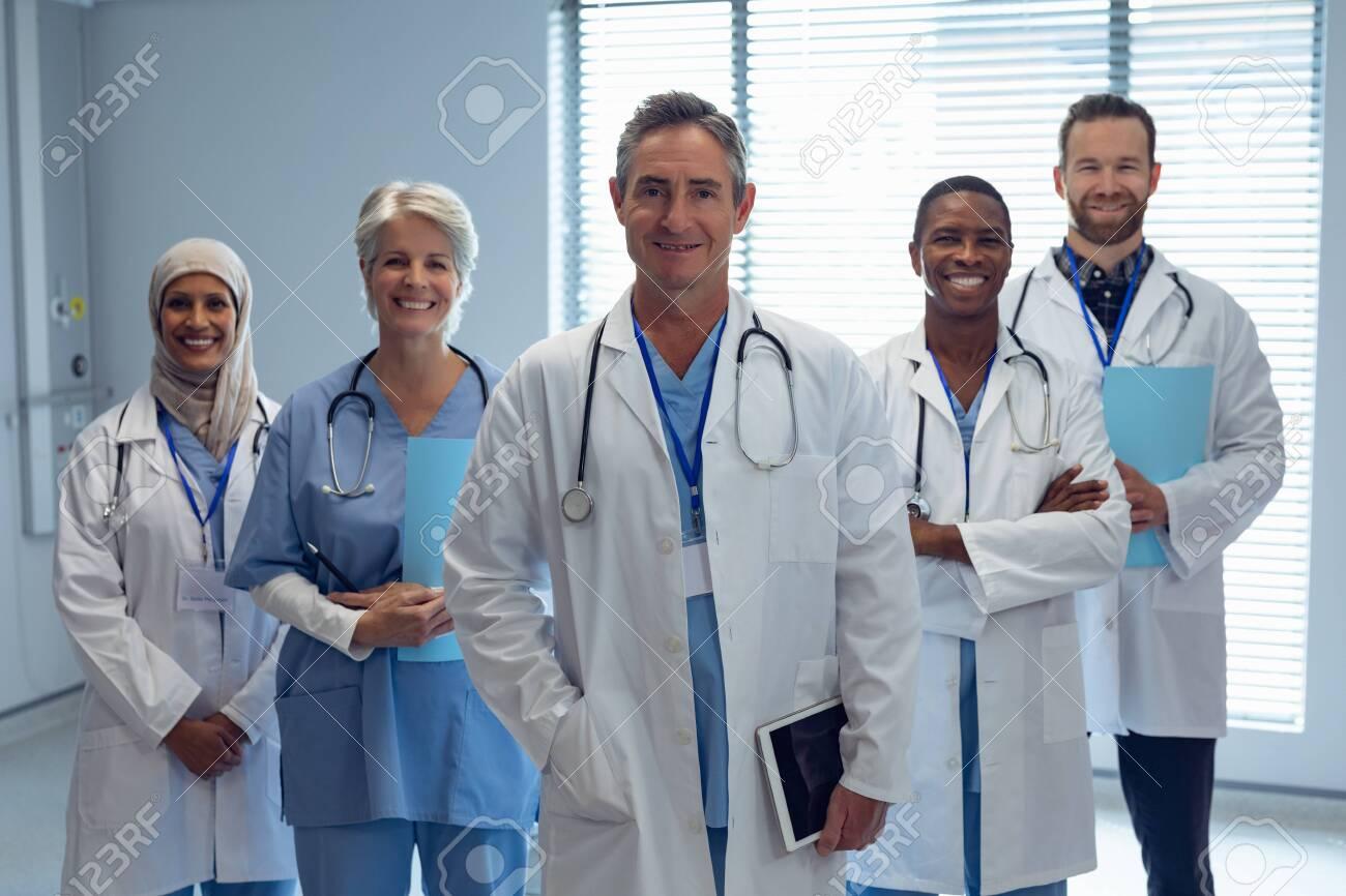 Portrait of medical diverse team standing together in hospital - 126112728