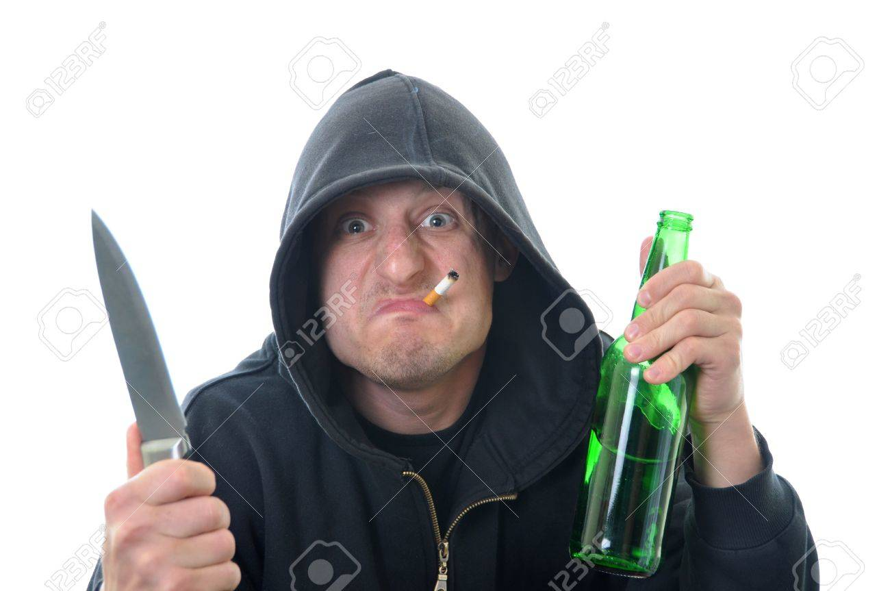 Bandit with knife and bottle of alcohol isolated on white background Stock Photo - 9507338