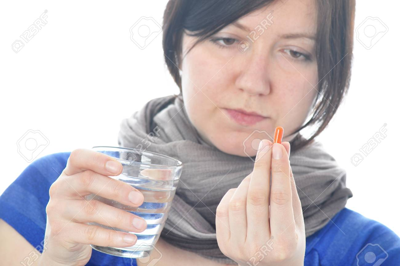 Woman with pill over white background Stock Photo - 18443839