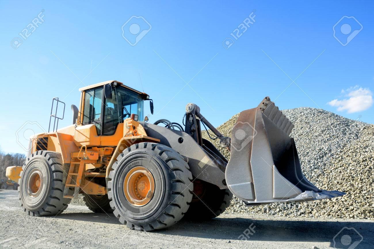 big yellow mining truck in quarry - 38637267