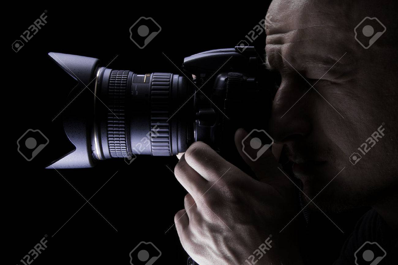 Young professional photographer taking pictures with digital camera - 46647660