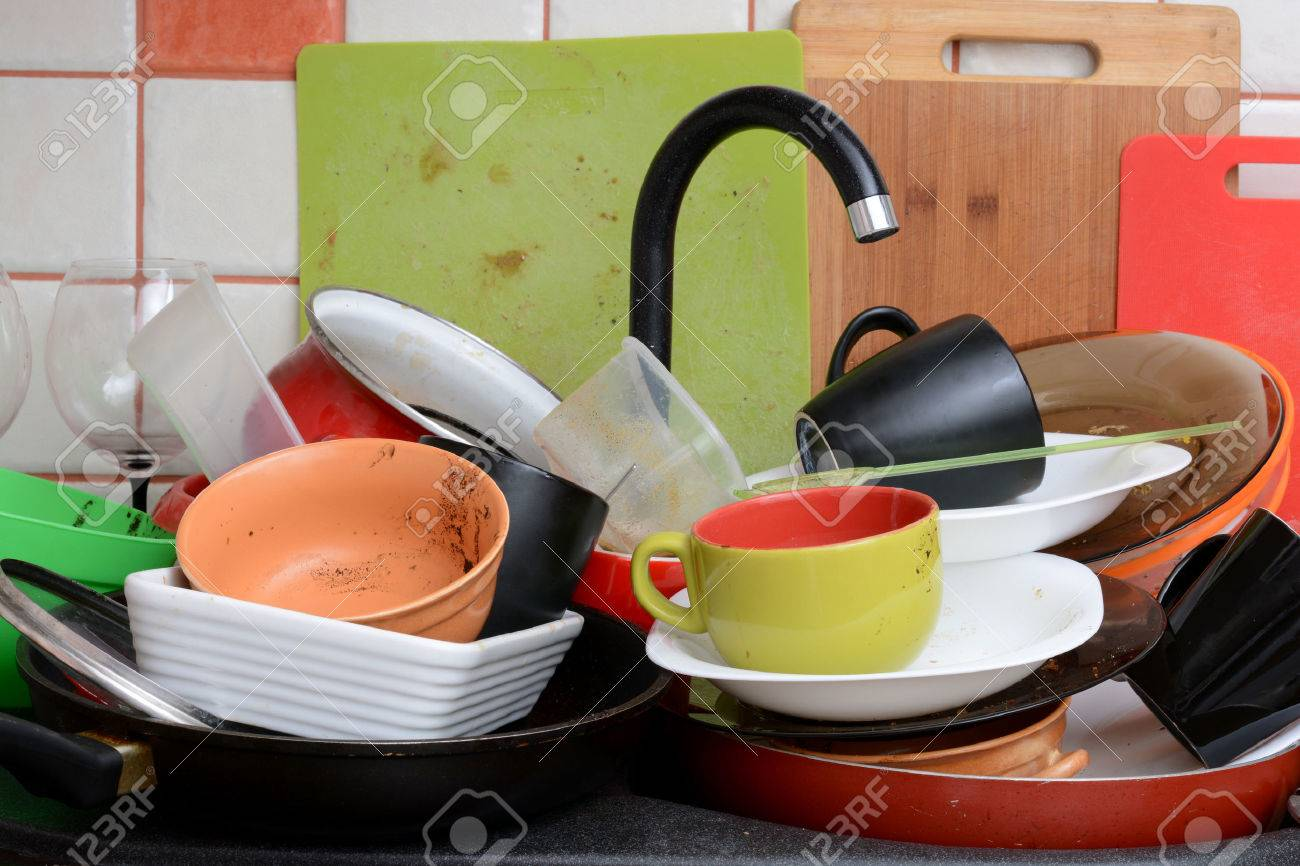 Pile of dirty dishes in the sink - 53563528